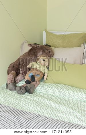 Kid's Bedroom With Green Color Tone And Dolls