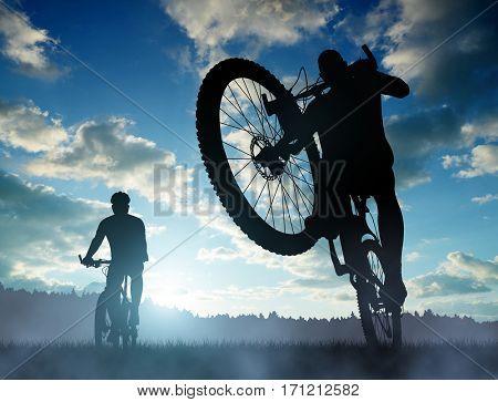 Cyclist riding a mountain bike at sunset