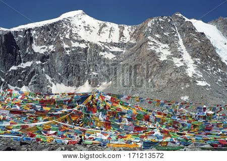 Tibetan prayer flags Lungta on the Drolma La Pass with altitude 5650 meters above sea level is the highest point of the ritual route around the Sacred Mount Kailash in Western Tibet.