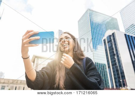 Smiling Girl With Smart Phone In Chicago
