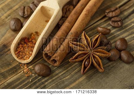 coffee beans spices and cinnamon star anise on wooden table