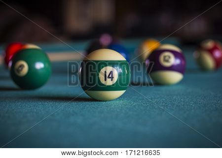 Billiard balls on a pool table Fourteen ball.