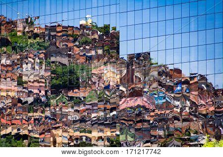 Reflection of Brazilian Slum in Windows of New Modern Business Building in Rio de Janeiro