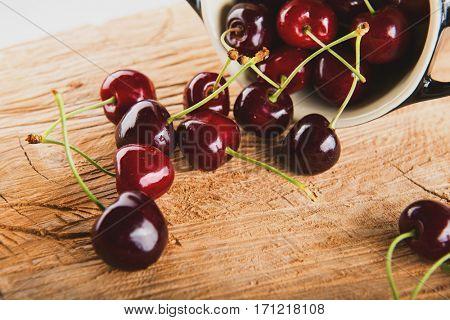Juicy cherries in black vessel