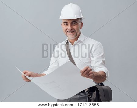 Architect Checking A Blueprint