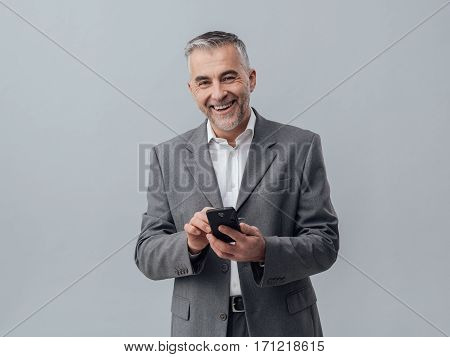 Businessman Texting With His Smartphone