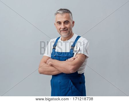 Plumber Posing With A Wrench
