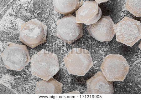Frozen meat dumplings selective focus. Background. Dumplings top view. Many dumplings. Varenyky pattern.