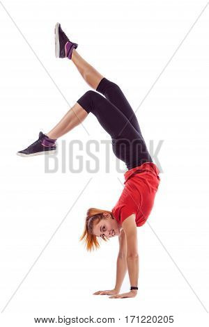 Beautiful Woman Is Standing On Hands, Holding Legs In Air. Isolated Over White Background