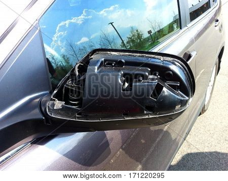 damaged broken rear view automobile car mirror