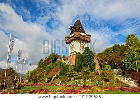 GRAZ/ AUSTRIA - OCTOBER 8. Clock tower at the top of the hill Schlossberg with garden in the foreground on October 8 2016 in Graz, Austria.