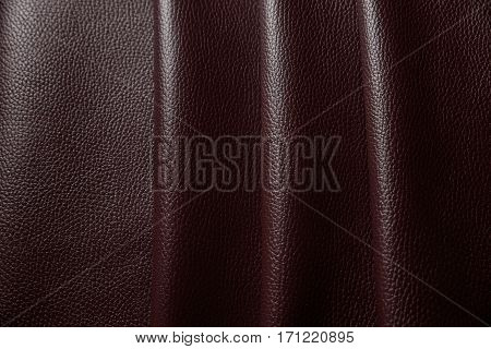 Red leather texture background close up macro.