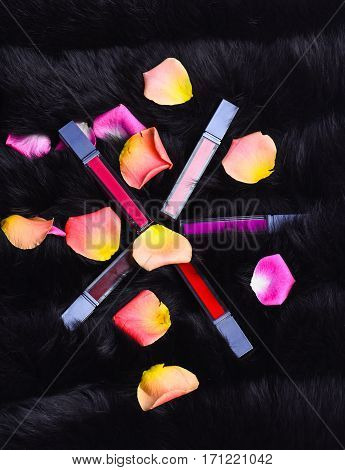Lipsticks With Rose Petals On Fur Background