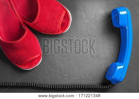 Red slippers with handset on the floor