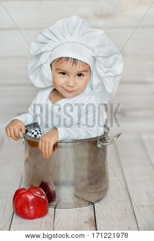 cute little baby. happy cute little child in a cook cap