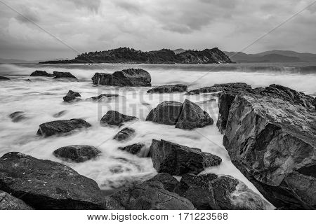 A black and white rocky coastline on the south China sea in Vung Lam Bay Vietnam.