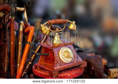 Close up shot of antique phone artifact and other handicrafts made in India