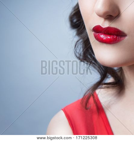 beauty closeup portrait of attractive young caucasian woman brunette on blue background studio shot red lips face closeup skin