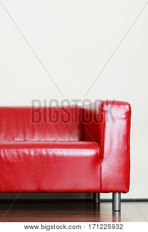 Interior objects home decorations and design concept. Detailed closeup leather red sofa couch