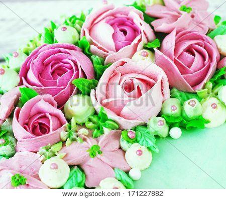 Birthday cake with flowers rose on white background toning