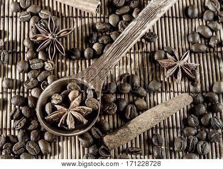 set of wooden utensils with star anise pepper cinnamon isolated on Mat
