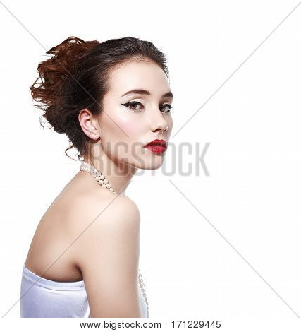 half length portrait of beautiful young woman with pearl necklace isolated on white background in photostudio