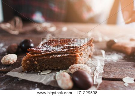 Sweet turkish baklava on wooden table. Closeup of tasty honey treat with nuts. Confectionery, bakery, traditional eastern pastry concept