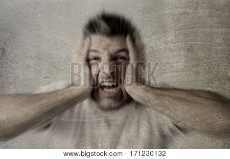 young man sad and depressed suffering depression feeling sorrow and pain screaming desperate with hands on his face in sadness emotion concept with zoom distorted effect