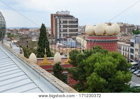 FIGUERES, CATALONIA, SPAIN - JUNE 17: Light of cloudy summer day is illuminating town roofs and  famous Dali Theatre and Museum on June 17, 2014 in Figueres, Catalonia, Spain.