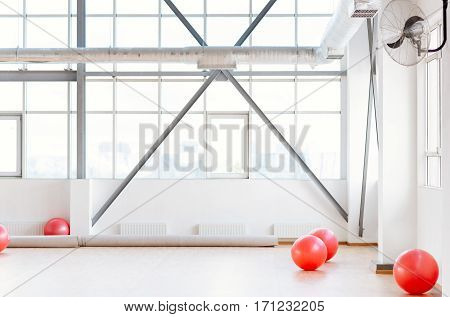 Place for fitness exercises. Close up of a large modern well equipped sports hall designed for fitness training
