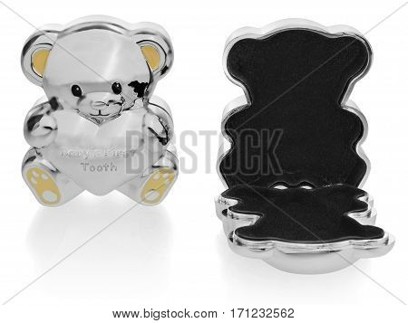 Silver box in the shape of a teddy bear to the first baby teeth. Closed and open toy box view on the front. The Children souvenirs lined inside with black velvet. Ears and feet in yellow on a white background with slight reflection.