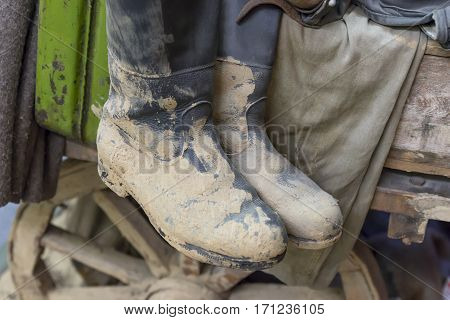 Dirty old pair of black leather boots from the army