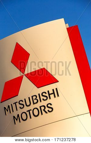 La rochelle France - August 30 2016: Official dealership sign of Mitsubishi against the blue sky. Mitsubishi Motors Corporation is a Japanese automotive manufacturer