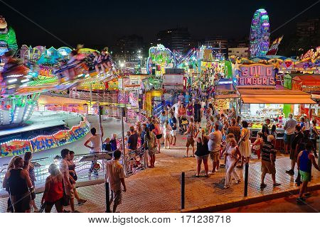 Torrevieja, Spain - July 28, 2015: Carousel at amusement park in the evening