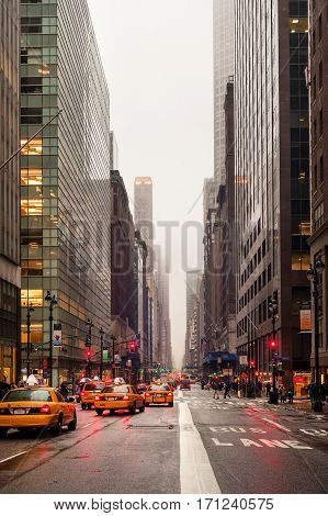 Taxis in rainy weather on Madison avenue on January 28, 2009 in Midtown Manhattan, New York City, USA