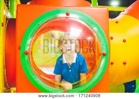 A Boy Looks Out From The Playground In Kindergarten