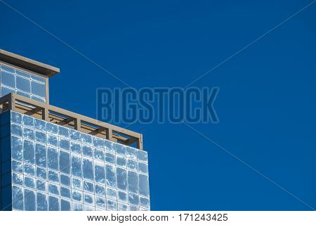 The sky reflected in the windows of a skyscraper