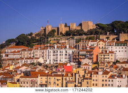 LISBON PORTUGAL - JANUARY 10 2017: São Jorge Castle in Lisbon as seen from Miradouro do Elevador de Santa Justa (view point at the top of Santa Justa Elevator).