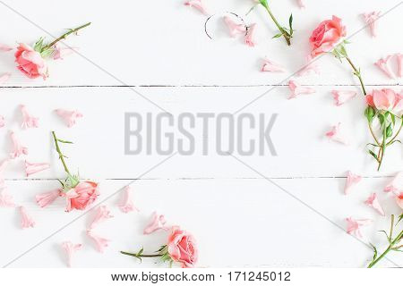 Flowers composition. Pink flowers on white wooden background. Valentine's Day. Flat lay top view