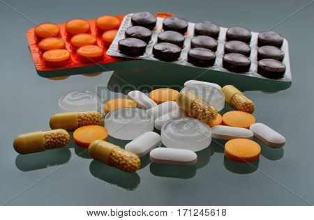 Various pills and vitamins. Pharmaceutical products. Multicolor drugs.