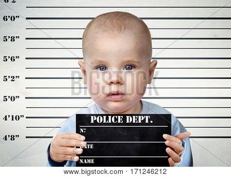 Little infant on a prison board