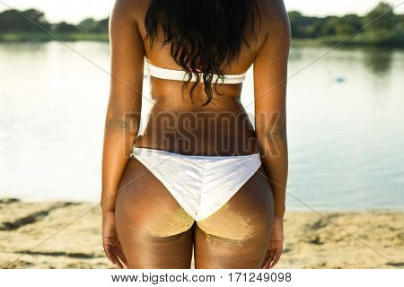 close up of a woman's body from behind