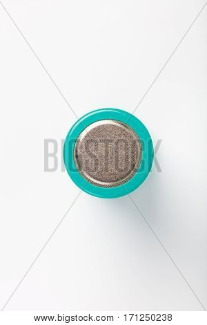 green battery negative with white background close up