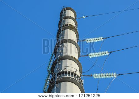 Supports High-voltage Power Lines Against The Blue Sky