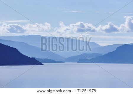 Norwegian fjord landscape in blue tone. Tourism Norway. Travel background