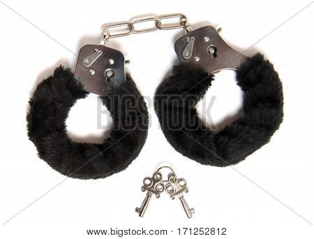 Black handcuffs and keys isolated on white