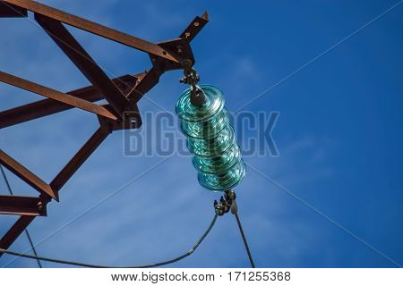 Glass Prefabricated High Voltage Insulators On Poles High-voltage Power Lines. Electrical Industry