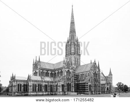 Cathedral Church of the Blessed Virgin Mary is an anglican cathedral in Salisbury England and one of the leading examples of early english gothic architecture with the tallest spire in UK. View from East in black and white.