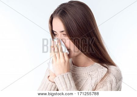 sick girl snoting in Hanky isolated on white