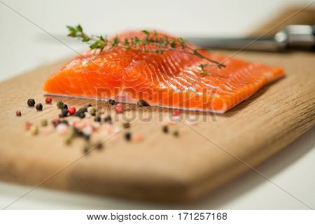 Fresh Trout Fillet With Herbs And Spices On Cutting Board